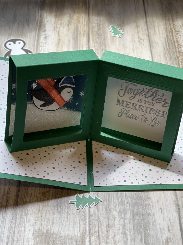 This is a card showing the inside of a pop up card with a penguin on the left hand side and a sentiment on the right hand side using the Penguin Patch Bundle from Stampin Up!